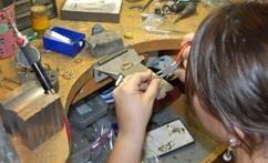 Jeweler working at bench, Gemstone Creations