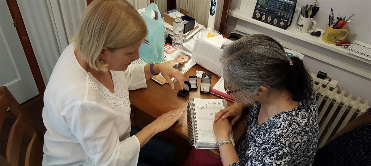 Nancy working with customer on Custom Design, Gemstone Creations
