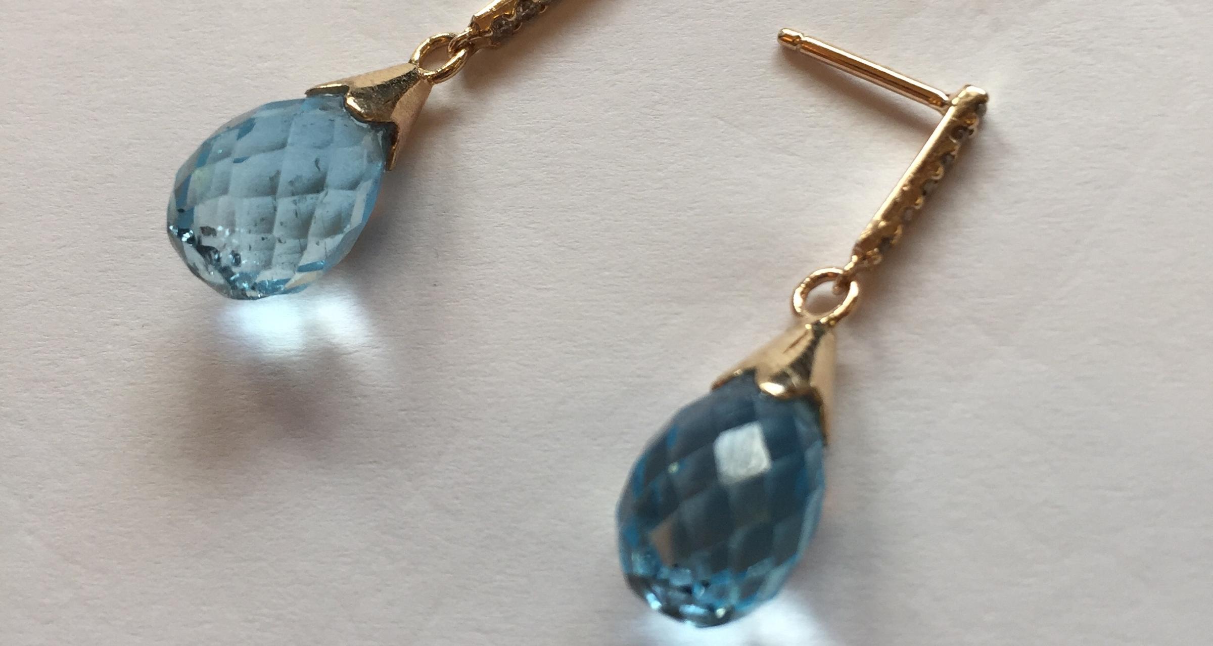Blue Topaz earrings by Gemstone Creations.