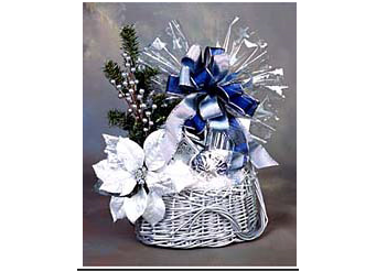 Picture of silver holiday gift basket filled with sweet and savory items.