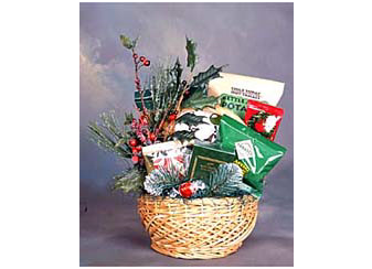 Christmas gift basket filled with pretzels, chips, cookies and cocoa.