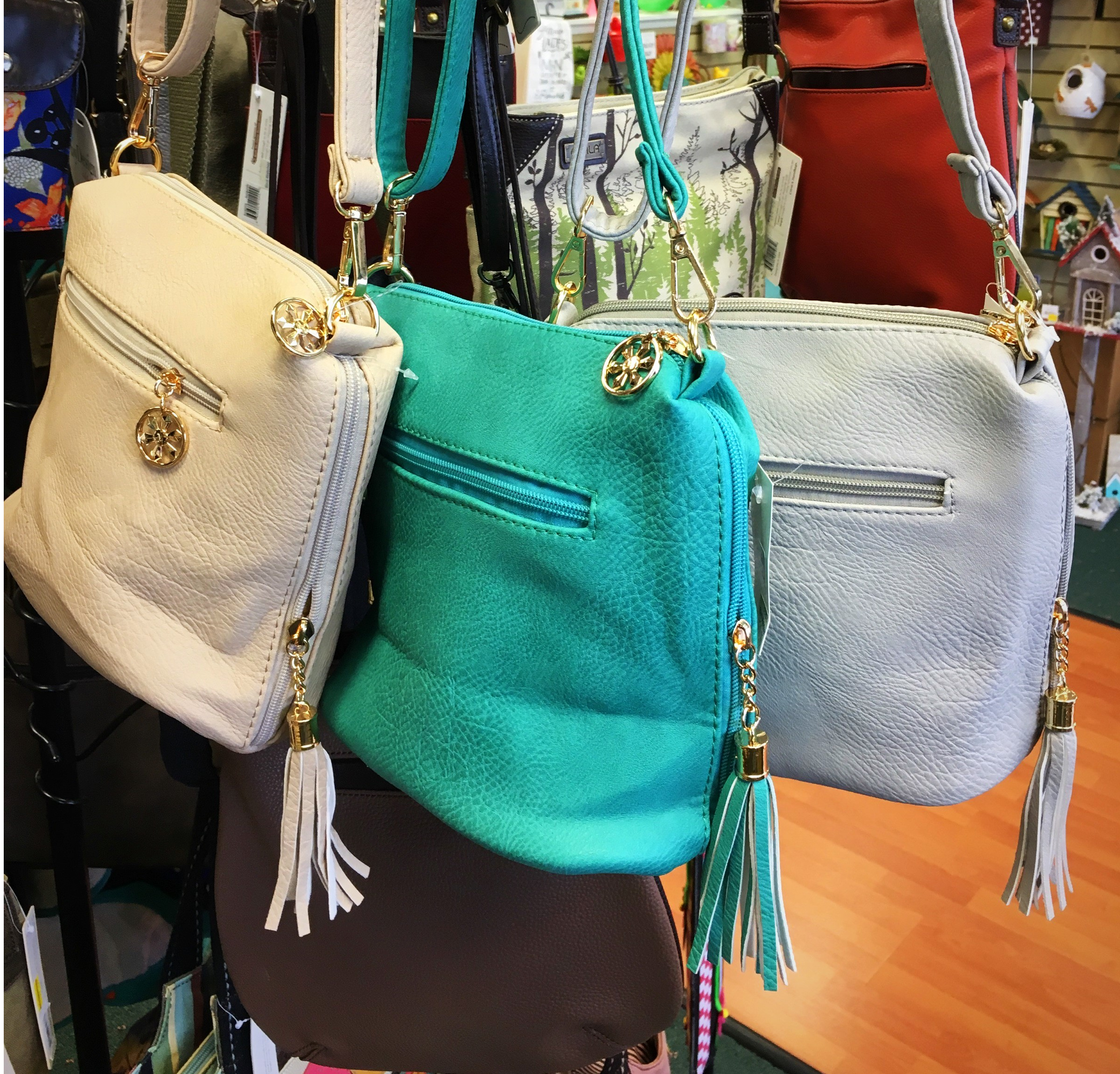 Jewelry, apparel, and bags available at Bird Watcher Supply Company