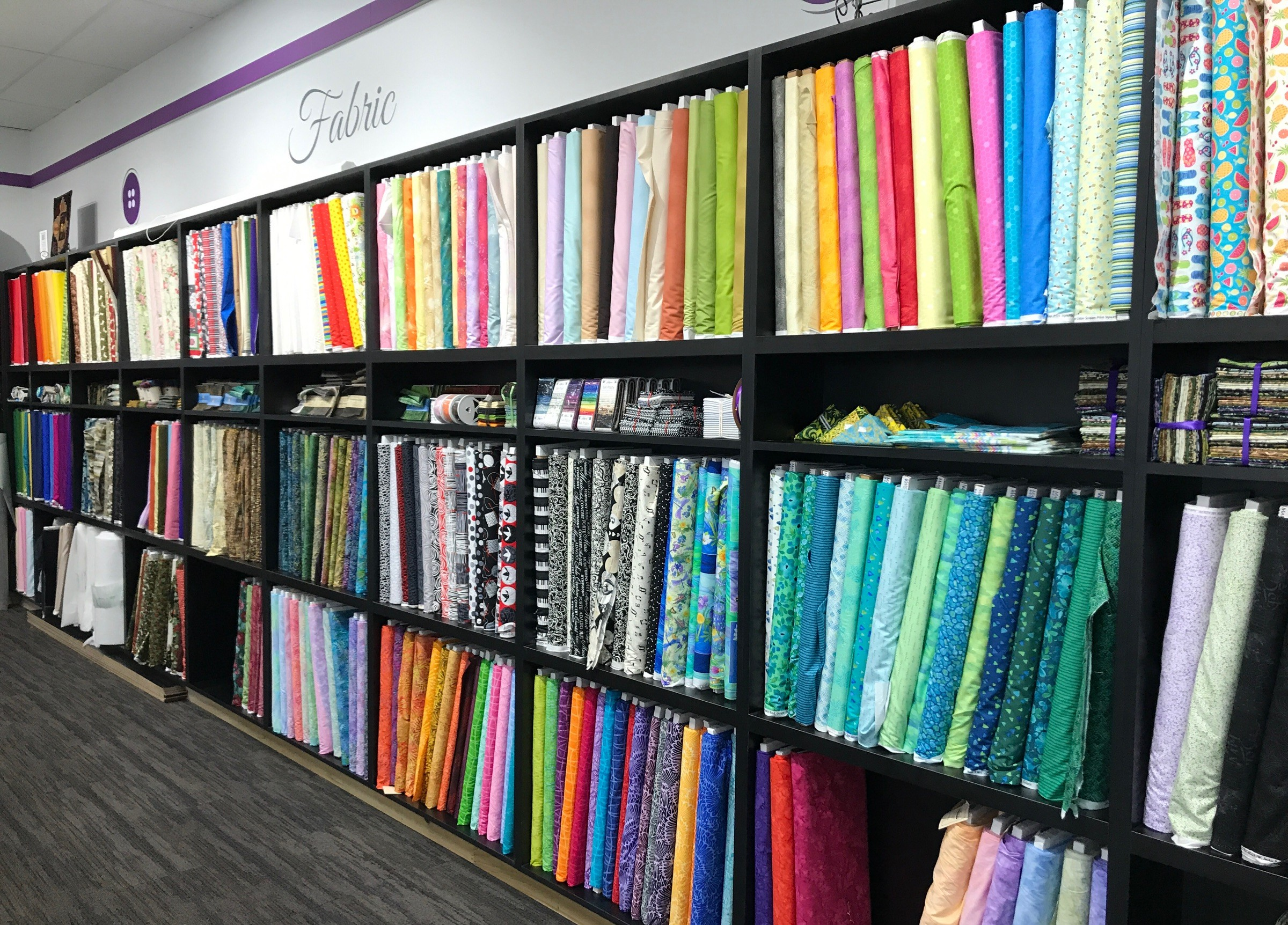 Display of fabric and patterns available at Frank's Sewing Center Sew Much More