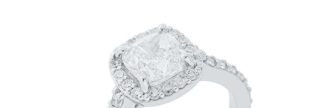 Cushion Cut Center with Round Diamonds