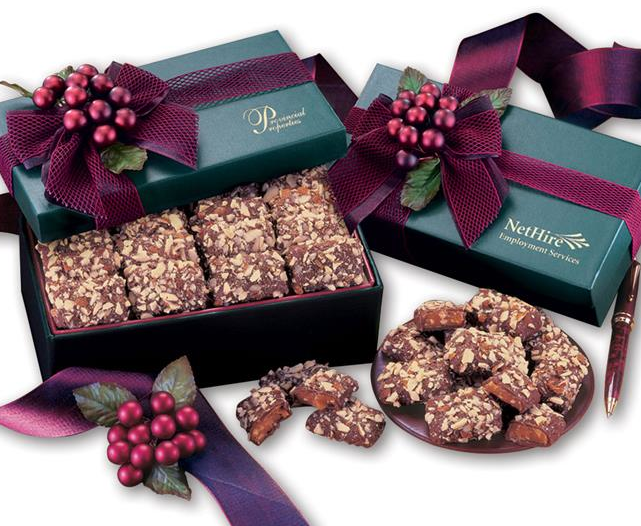 Chocolate Pecan Butter Toffee in a Gift Box tied with a pretty bow and holiday berries.