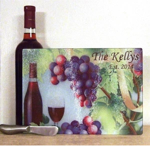 Wine theme with grapes  cutting board with knife spreader