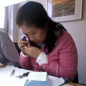 Nancy grading diamonds in Antwerp, Gemstone Creations