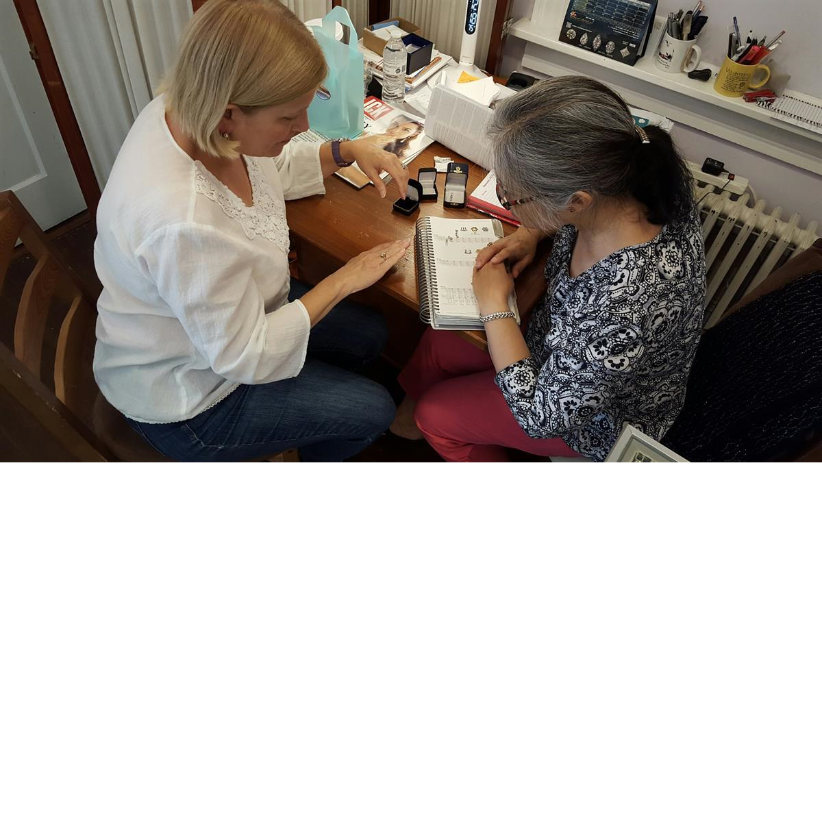 Nancy working with customer on Custom Design, Gemstone Creations