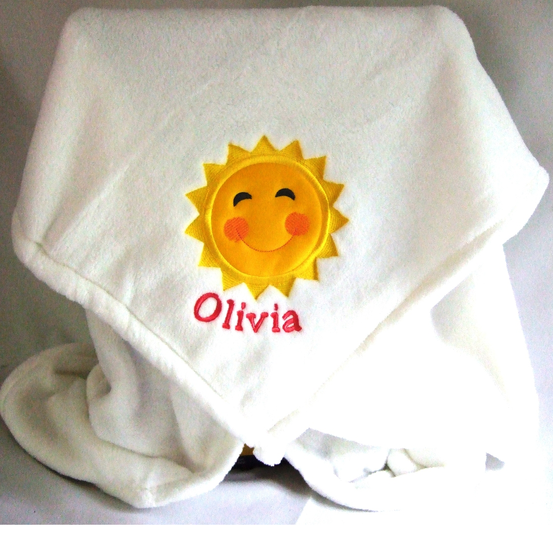 Personalized baby blanket with sun applique