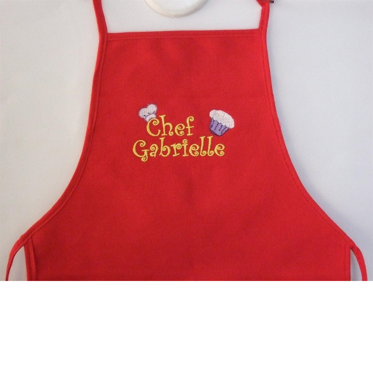 Child's red apron with chef hat and cupcake