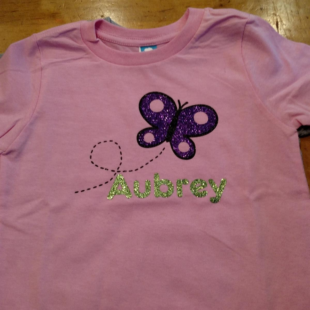 Pink custom youth tee with glitter name & butterfly