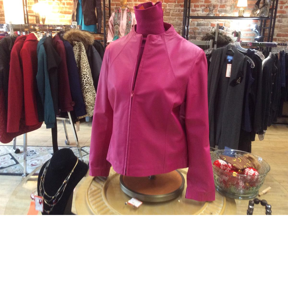 Consigned women's leather jacket and top at Refashion Consigned Furniture and Clothing