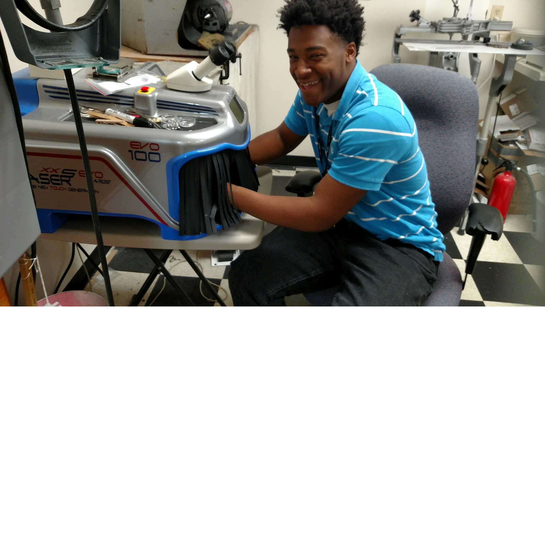 Isaiah Gibson working at the laser welder.